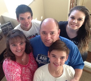Kristyn with her husband Scott, daughter Alyssa (22), and sons Brandon and Bryson. Not pictured: eldest son Anthony (26)